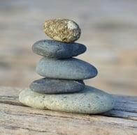 stones_balanced_on_wood_cropped_.jpg