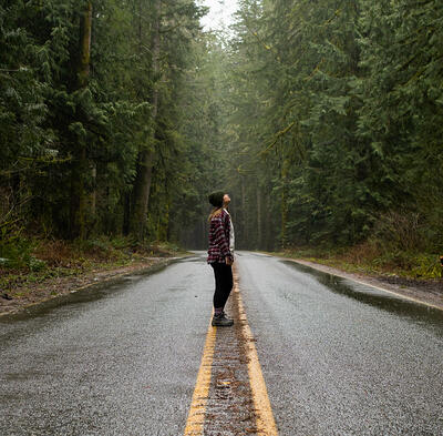 person-standing-on-road-3611540-1000px